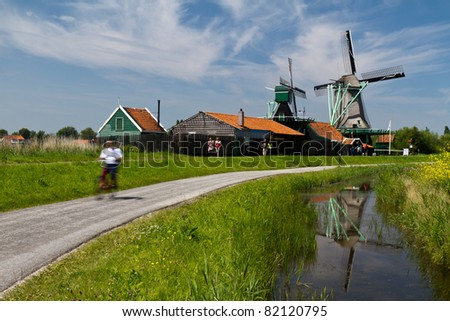 Relax on the bikes near the windmills area in Holland - stock photo