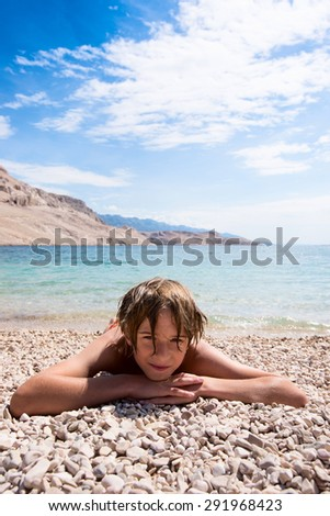 relax on the pebble beach - stock photo