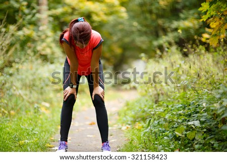 relax, tired woman after sport in park - stock photo