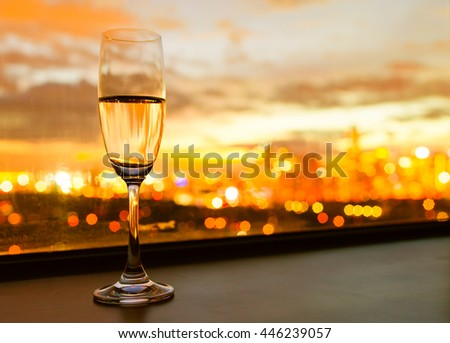 Relax with a glass of champagne and beautiful city views.  - stock photo