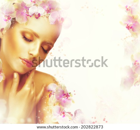 Relaxation. Dreamy Genuine Exquisite Woman with Flowers. Romantic Floral Background - stock photo