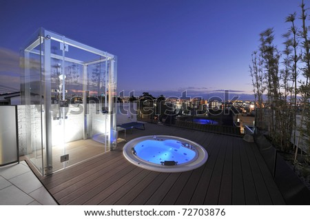 Relaxation in luxury bubble bath at night on blue - stock photo