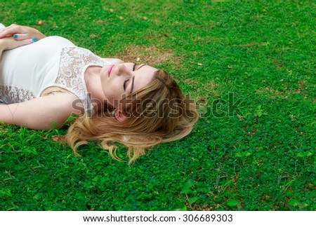 Relaxation Woman Lying Down On The Grass - stock photo
