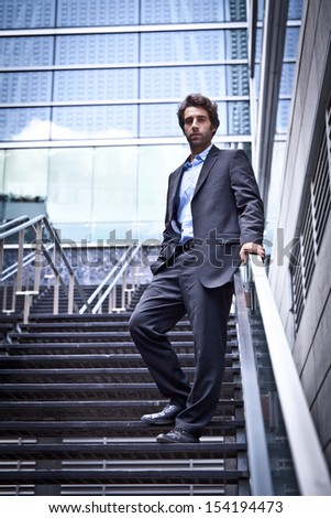Relaxe Business man standing outside his office - stock photo