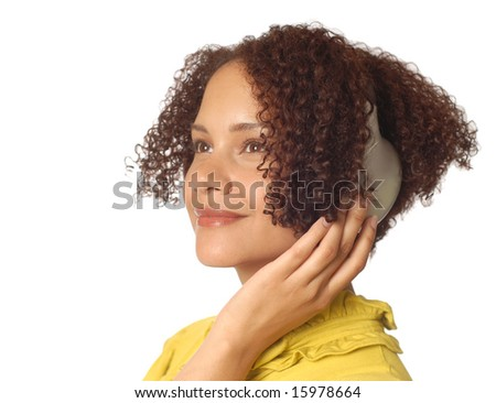 Relaxed and composed young woman listening to music - stock photo