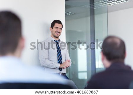 Relaxed cheerful team leader and business owner leading informal in-house business meeting. Business and entrepreneurship concept. - stock photo