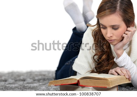 relaxed girl reading a book - stock photo