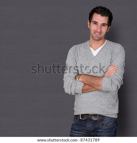 Relaxed handsome guy on dark background - stock photo