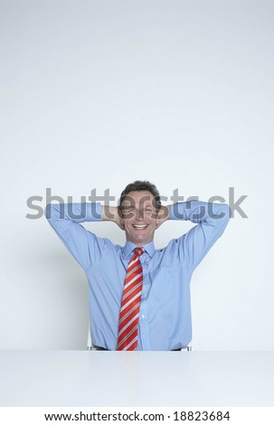 relaxed happy businessman - stock photo