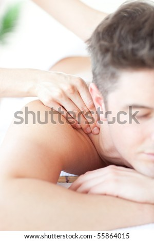 Relaxed man enjoying a back massage in a Spa center - stock photo