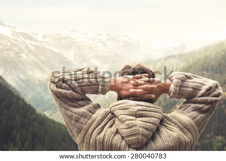 relaxed man observing majestic mountain  - stock photo