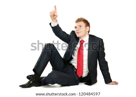 Relaxed mature business man sitting on the floor - stock photo