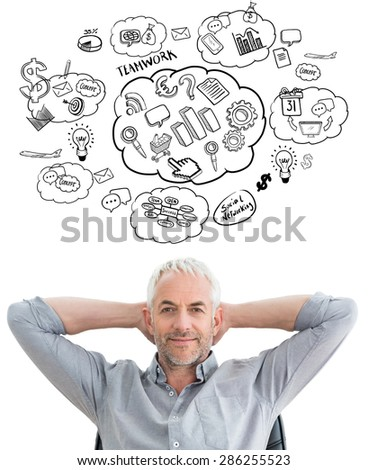 Relaxed mature businessman with hands behind head against brainstorm - stock photo