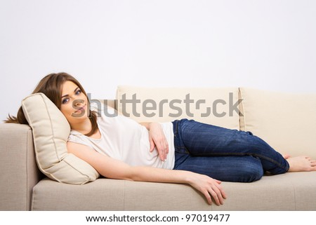 Relaxed woman lying on bed. - stock photo