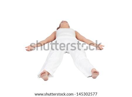 Relaxed woman lying upwards isolated on white background - stock photo