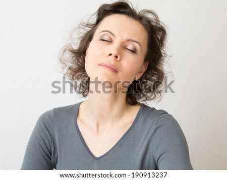 Relaxed woman with closed eyes in meditation - stock photo