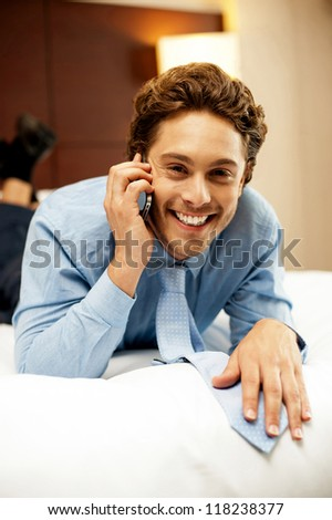 Relaxed young businessman communicating with his partner. Calm and cool, personal talk - stock photo