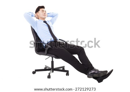 relaxed Young businessman sitting in a chair isolated - stock photo