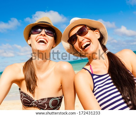 Relaxed young friends having fun on the beach - stock photo