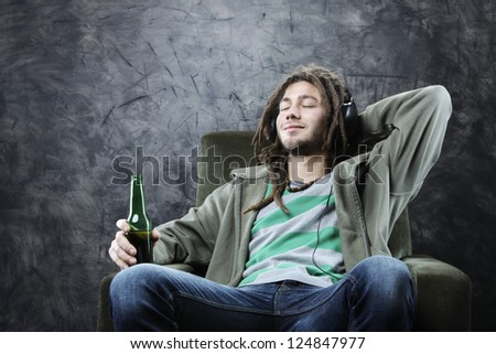 relaxed young man enjoying music - stock photo