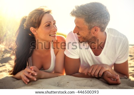 relaxing after fitness workout in the sand - stock photo