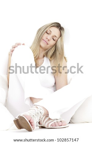 relaxing and sitting woman wearing white clothes and sandals - stock photo