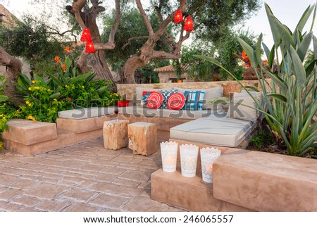 relaxing area in a garden of a holidays resort  - stock photo