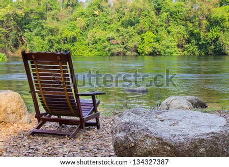 Relaxing area on riverside. - stock photo
