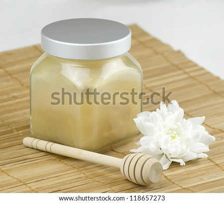 relaxing aroma of almond coconut vanilla milk and honey bath foam over wooden mat - stock photo