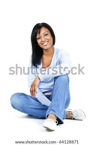 Relaxing black woman sitting on floor isolated on white background - stock photo