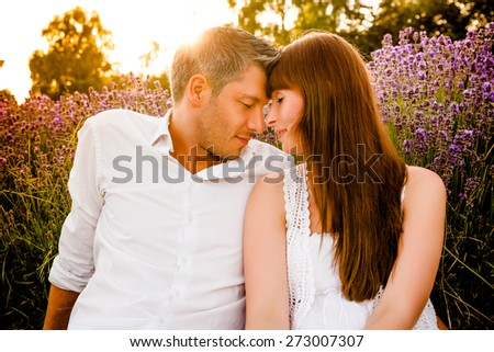 relaxing both with sunlit shiny hairs - stock photo