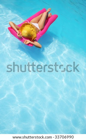 Relaxing in a pool, similar available in my portfolio - stock photo
