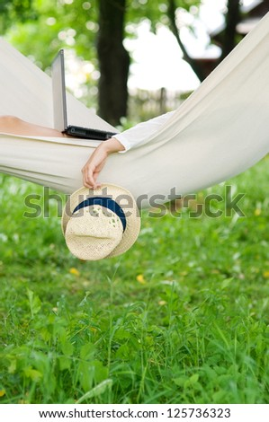 Relaxing on hammock - stock photo