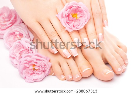Relaxing pedicure and manicure with a pink rose flower - stock photo