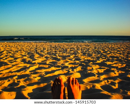 Relaxing time with golden sand at Bondi beach ,Sydney in late afternoon. - stock photo