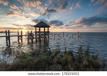 Relaxing Waterfront Coastal Gazebo at Sunset in Outer Banks North Carolina - stock photo