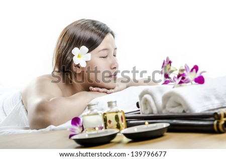 Relaxing young lady in spa and massage concept - stock photo