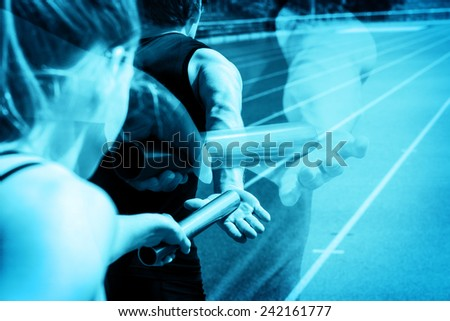 Relay race handing over from woman to man, implemented as a ghosting scene. - stock photo
