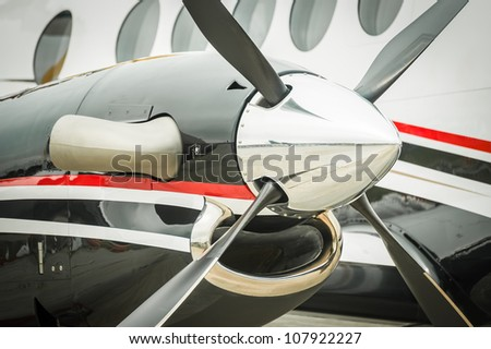 relection of a runway on a propeller engined aircraft - stock photo