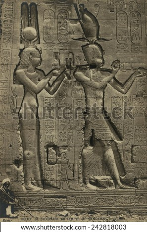 Relief sculpture of Cleopatra VII (69-30 BC), and her son by Julius Caesar, Caesarion, at the Temple of Hathor, Dendera. Ca. 35BC. - stock photo