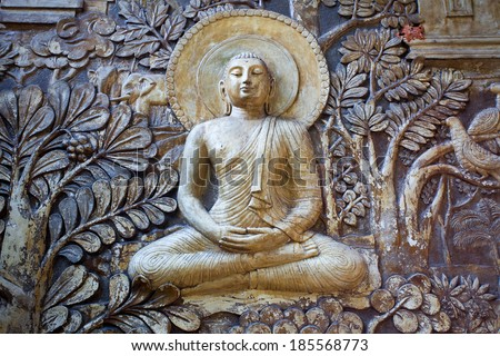 relief sculpture on the wall of a Buddhist temple in Colombo Sri Lanka island - stock photo