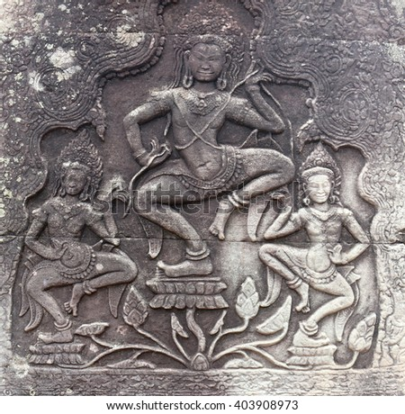 Relief statue on ancient temple - stock photo