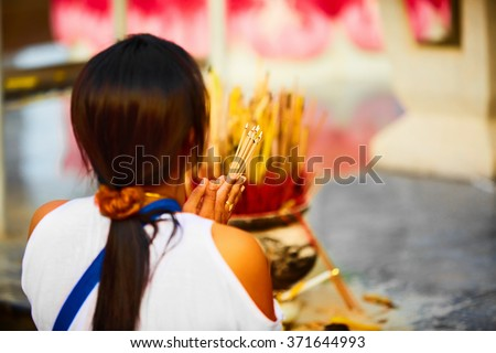 Religion. Close Up Of Young Asian Woman Praying Buddha Holding Burning Incense Aroma Sticks In Hands At Wat Phra Yai, The Big Buddha Temple At Koh Samui, Thailand. Buddhism. Belief And Faith. - stock photo