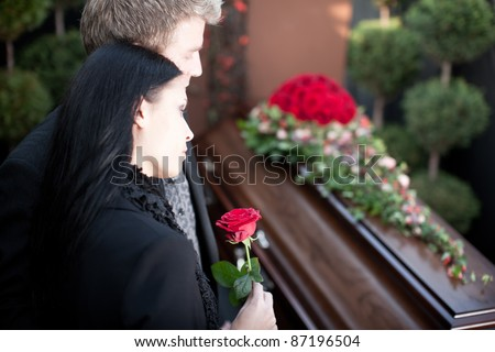 Religion, death and dolor  - funeral and cemetery; funeral with coffin - stock photo