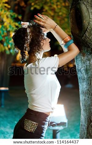religious girl praying outdoor at nighttime - stock photo