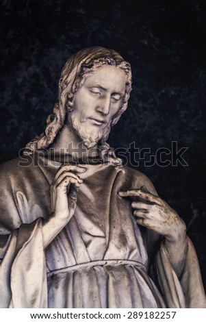 Religious Jesus Christ Statue as part of Christian Cemetery Monument - stock photo