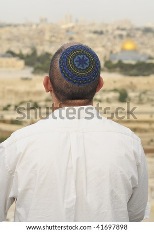 Religious Jew prays in Jerusalem at Succoth celebration - stock photo
