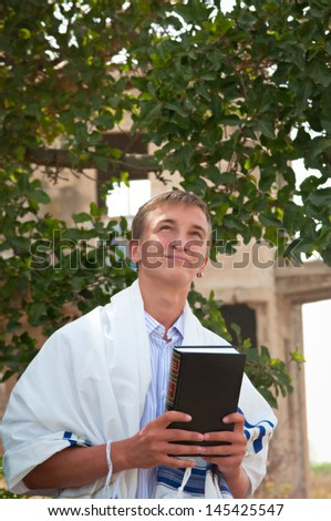 Religious Jewish teenager with a book in hand . - stock photo