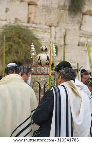Religious Jews sunrise prayer service at the Western Wall, Jerusalem, Israel - stock photo
