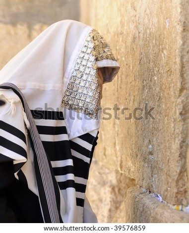 Religious orthodox Jew prays at the Wailing wall, Jerusalem, Israel - stock photo